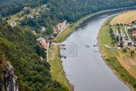 Photo for Aerial view of boats on elbe river, fields and small town in Bad Schandau, Germany - Royalty Free Image