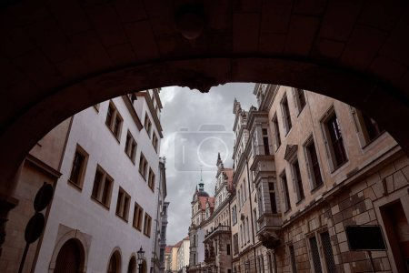 arch and street with old historical buildings in Dresden, Germany