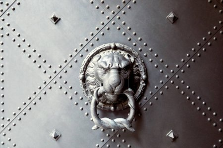 Photo for Antique doorknocker with lion head on metal door in Dresden, Germany - Royalty Free Image