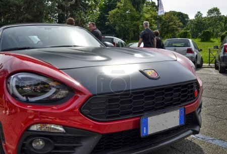 Photo for Turin, Piedmont, Italy. June 2018. At the Valentino park, the detail of the nose of an abarth 124 spider. The logo with the scorpion, symbol of the abarth house, is in plain sight. - Royalty Free Image