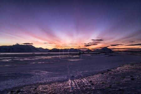 Photo for Amazing colorful sunset over snowy cold and icy landscape - Royalty Free Image
