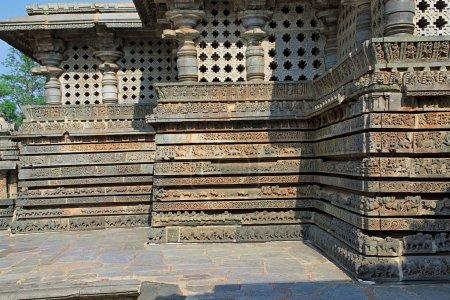 Friezes of animals, scenes from mythological episodes from Ramayana and Mahabharata, at the base of temple, Hoysaleshwara temple, Halebidu, Karnataka, India. View from South.