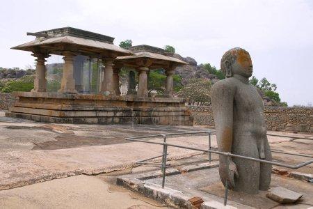 A rare statue of Bharata, brother of Bahubali, Chandragiri hill temple complex, Sravanabelgola, Karnataka India Jain basadis in the background.