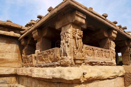 Carved figures and floral patterns on the decorated sober and square pillars of the sabha-mandapa of Lad Khan temple, Aihole, Bagalkot, Karnataka, India. Kontigudi group of temples.