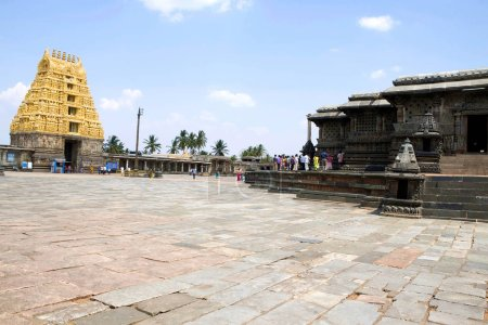 BELUR, KARNATAKA, INDIA, May 2016, Tourist, visitors at North East courtyard Chennakeshava temple complex with East Gopuram on the left and Swarga Dwara, Door to Heaven, on the left