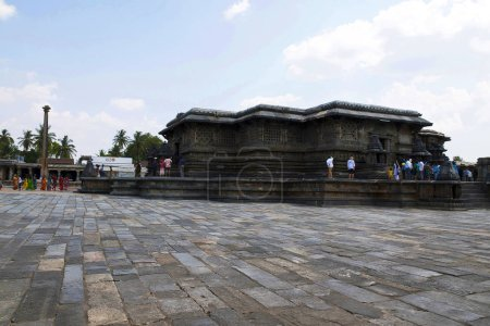BELUR, KARNATAKA, INDIA, May 2016, Tourist, visitors at Chennakeshava temple complex, Lam post on the left and the Swarga Dwara, Door to Heaven, on the right