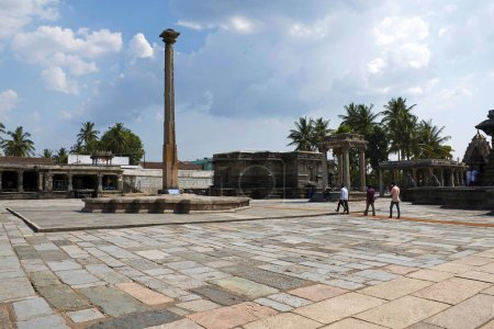 BELUR, KARNATAKA, INDIA, May 2016, Tourist and visitors at South East courtyard with visible lamp post and Kappe Chennigaraya temple Chennakeshava temple complex