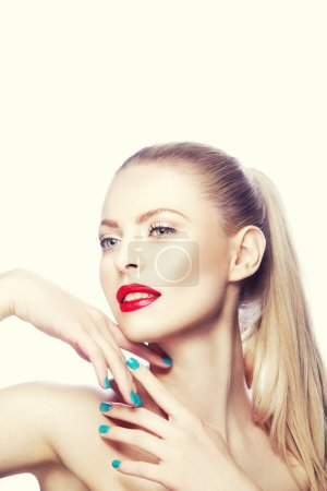 Photo for Portrait of woman with red lips and blue nail polish - Royalty Free Image