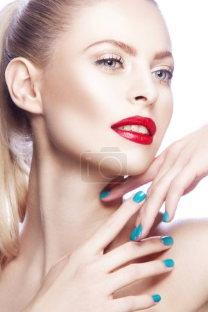 Portrait of woman with red lips and blue nail polish
