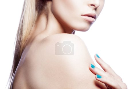 Photo for Cropped portrait of woman with natural makeup and blue nail polish - Royalty Free Image