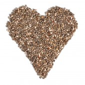 Top view on chia (Salvia hispanica) seeds arranged in shape of heart, isolated on white background. Food for healthy cardiovascular system concept.