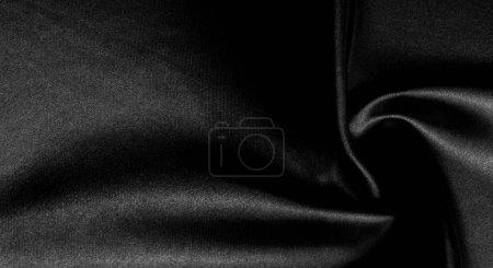 Photo pour Texture, fond, motif. Tissu en soie noire. Il est noir et résistant à la chaleur avec du gris. Transformez son rideau plus résistant en un design pour tout événement. C'est une main croustillante, légèrement texturée . - image libre de droit