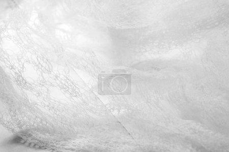 Photo pour Texture fond motif tissu blanc dans une maille Merci à une combinaison unique et design propre c'est un tissu impressionnant Il est idéal pour toutes sortes de votre conception, décor, décorations, fonds d'écran - image libre de droit