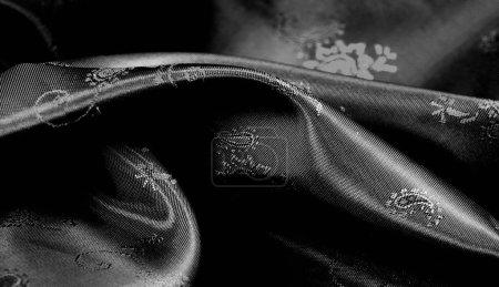 Photo pour Texture, tissu en mousseline de soie noire avec imprimé paisley. fabuleux tissu doux et sombre, avec un beau motif paisley en gris, il serait tout aussi beau pour votre conception, papier peint, affiches - image libre de droit