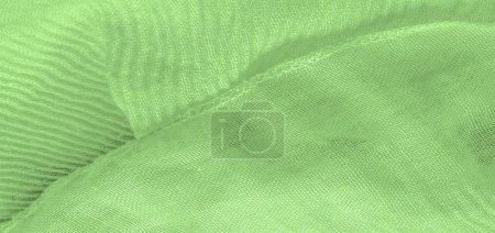 Photo pour Texture, fond, motif, soie verte ondulation tissu broyé pour vos projets - image libre de droit