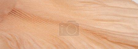 Photo pour Texture, fond, motif, tissu broyé en soie ondulée beige pour vos projets - image libre de droit