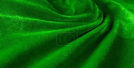 Photo pour Motif, texture, fond, tissu de velours vert, tourner les têtes dans ce tissu de velours luxueux. Ceci est un tissu ultra-doux, Il est parfait pour vos projets. Un sentiment de sophistication ! - image libre de droit