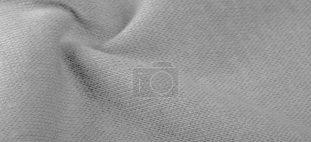 Photo pour Contexte, texture, motif, tissu de laine blanche, poils fins, bouclés ou ondulés formant les poils d'un mouton, d'une chèvre ou d'un animal similaire, en particulier lorsqu'ils sont utilisés dans la fabrication de tissus ou de fils. - image libre de droit