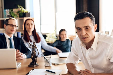 Adult puzzled man making decision about signing marriage dissolution agreement