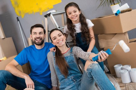 Photo for Happy family going to making repairs in new apartment - Royalty Free Image