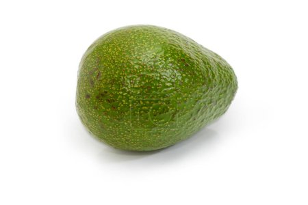 Whole green-skinned pear-shaped avocado fruit on a white background