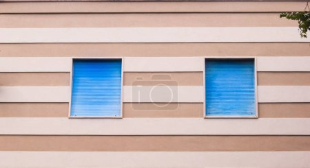 Blue roller shutter with white lines and dove gray lines