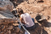 Professional archaeologist is digging in search of historical finds in Spain