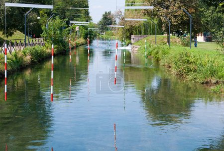 Bicolored poles of route for canoe on the river