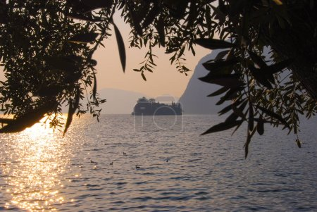 Profile of Little island in the middle of Iseo lake during the sunset reflexing