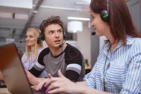 Cheerful call center operator at work