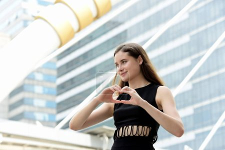 Photo for Beautiful young caucasian woman in showing heart sign - Royalty Free Image