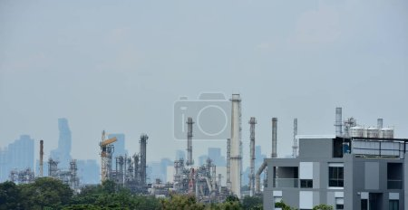 Photo for Oil refinery plant in the city - Royalty Free Image