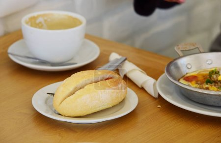 Photo for Breakfast and bread on wooden table - Royalty Free Image