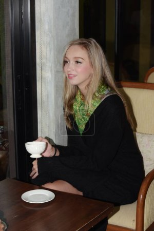 Photo for Young woman drinking coffee in cafe - Royalty Free Image