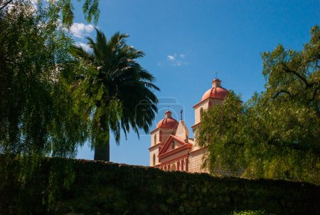 Photo for Santa Barbara Mission view during the day with a stone wall in foreground. - Royalty Free Image