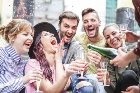Photo for Group of happy friends doing party throwing confetti and drinking champagne outdoor - Young people having fun celebrating birthday together - Friendship and youth holidays lifestyle concept - Royalty Free Image