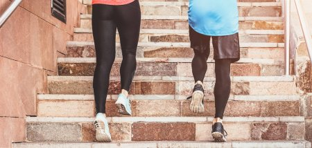 Photo for Close up runners legs training outdoor - Young couple doing a workout session on stairs outside - Health people, and sport lifestyle concept - Royalty Free Image