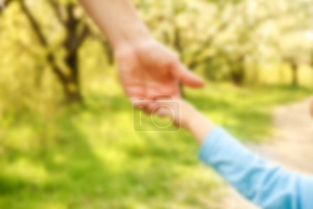 Photo for The parent holding the child's hand with a happy background - Royalty Free Image