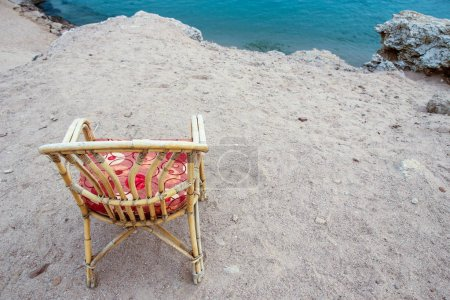 Photo for Stylishly beautiful chair on the sea nature landscape background - Royalty Free Image