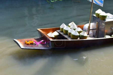 Exotic food on boat, floating market in Thailand