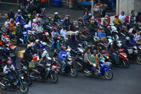 Bangkok, January 8, 2014 : Many people on motorbikes on street of Bangkok
