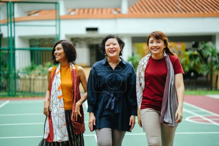 diverse group of asian women walking together on basketball court