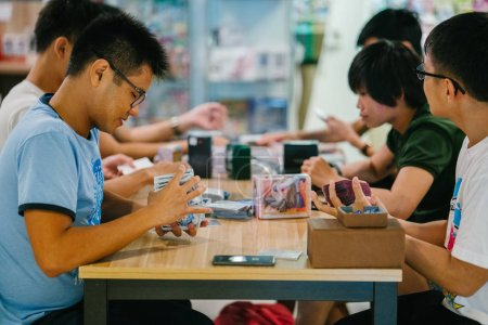 Photo for Singapore, August 2018: Asian students in public library, education concept - Royalty Free Image