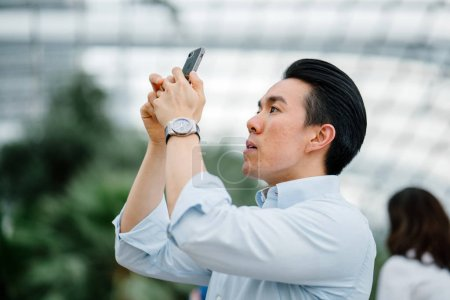 Photo for Young asian business woman with mobile phone - Royalty Free Image