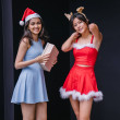 Two young Asian girls (one Indian, one Chinese) ex...