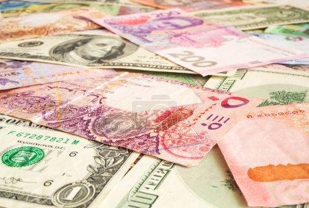 Cash money from various countries (Dollar, Qatari ...