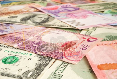 Banknotes from different countries overlapping eac...