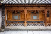 Traditional Wooden Chinese Architecture Of One Storie House. Courtyard Of A Renovated Oriental Building. Carved Details Of Timber.