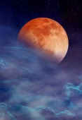 Red moon or blood moon with many stars and clouds. Beautiful night landscape of sky with super moon behind partial cloudy. Serenity blue nature background. The moon taken with my camera.