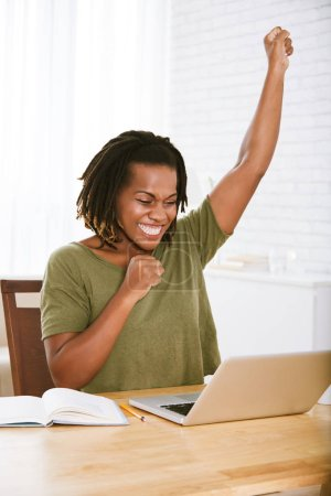 Excited happy woman reading e-mail with good news on her laptop